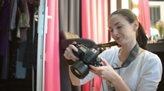 Woman Fashion Photographer works with Model at the Studio Stock Footage