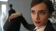 Beautiful brunette model posing in the strict business suit - stock footage