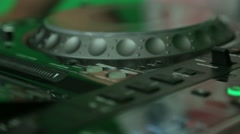 DJ turn the knobs on the mixer close up - stock footage