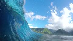 FPV SLOW MOTION: Rider surfing big tube barrel wave - stock footage