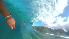 FPV SLOW MOTION: Pro surfer surfing big tube barrel wave - stock footage