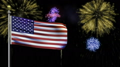 Stock Video Footage of American flag with Fourth of July fireworks