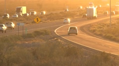 Freeway traffic driving toward bright sunset timelapse Stock Footage