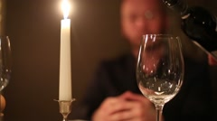 Glass and candle close up and man on the background Stock Footage