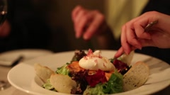 Woman eating a salad in a restaurant close up - stock footage
