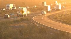 Freeway traffic driving toward bright sunset Arkistovideo
