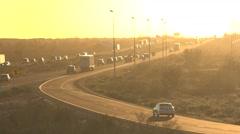Freeway traffic driving toward bright sunset timelapse Arkistovideo