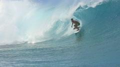 SLOW MOTION: Extreme surfer surfing inside big tube barrel wave - stock footage