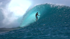SLOW MOTION: Extreme surfer surfing inside big tube barrel wave Stock Footage