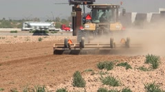 Yellow agricultural tractor plowing, cultivating - stock footage