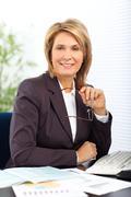 Smiling mature business woman. Stock Photos