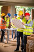 Architect and construction worker look blue print Stock Photos