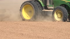 Green agricultural tractor plowing, cultivating - stock footage