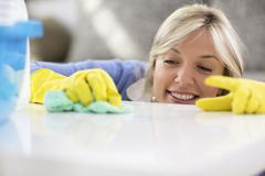 Maid erase table with clothe - stock photo