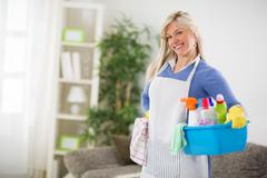 Female is ready for cleaning house Stock Photos