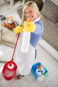 Fanny hostess make joke with products for cleaning house Stock Photos