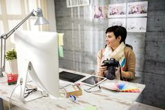 Employed woman working in photo studio. - stock photo