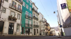 historic 100 years old yellow tram old street in Lisbon steady cam gimbal - stock footage