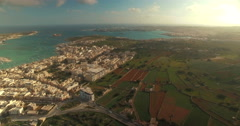 A High aerial shot close to a European beach on a sunny day Stock Footage
