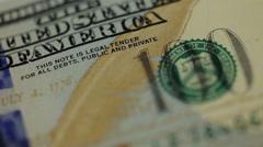 Stock Video Footage of Cash money background. Benjamin Franklin portrait on 100 US dollar bill close up