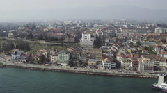 Nyon old town and lake Geneva by aerial view Stock Footage