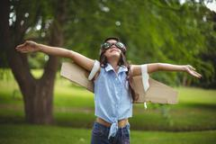 Young girl pretending to fly Stock Photos