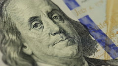Cash money background. Benjamin Franklin portrait on 100 US dollar bill close up Stock Footage