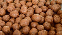 Pile of sweet chocolate balls cereal breakfast supper cornflakes pouring - stock footage