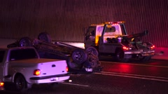 Truck Rollover Crash On Freeway With Traffic Driving By At Night Stock Footage