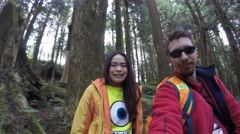 4k, Happy Couple of tourist in the forest of the mountain resort in Alishan-Dan - stock footage