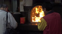 4k Man is burning the Joss paper for his ancesters in a temple of Taiwan-Dan - stock footage