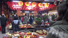 4k, Asian people pray in templo of Guanyin in Taipei. Offerings food -Dan Stock Footage