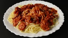 Italian spaghetti pasta cuisine food with chicken tomato sauce is ready to eat Stock Footage