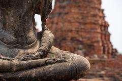 Old statue of buddha mediating, Ayutthaya - stock photo