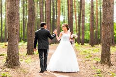 Bride and groom dancing  in nature. Wedding dance outdoors - stock photo