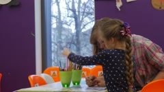 Teacher Painting With Kid Children's Day Library Opole Poland People Choosing Stock Footage