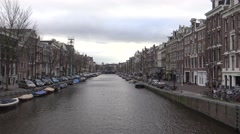 4k, Tradicional dutch houses near a canal of center in Amsterdam, Holland-Dan Stock Footage