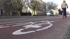 4k, Bike Lane and Trams in the street of the center in Amsterdam, Holland-Dan Stock Footage