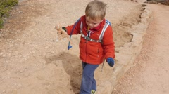 Little boy walking on trail in Bryce Canyon National Park Stock Footage