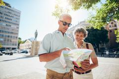 Couple travelling in city with a road map - stock photo