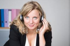 Gorgeous call center operator. Head and shoulders shot isolated - stock photo