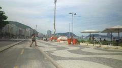 Ridding a bicycle on Copacabana Beach walkway , Rio De Janeiro. Stock Footage