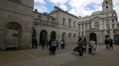 Tourists with babies walking near The Household Cavalry Museum, London Stock Footage