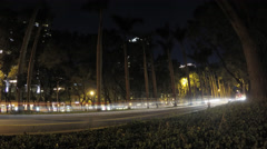 4k Timelapse of night, Traffic cars crossing urban street near to the park-Dan Stock Footage
