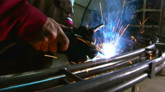 Gas welding a metal pipe Stock Footage