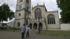 Tourists standing in front of St Margaret's Church in London Stock Footage