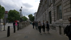 Young people walking by the The Household Cavalry Museum in London Stock Footage