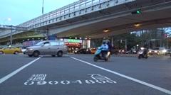 4k Traffic cars and people crossing urban street in the night-Dan - stock footage