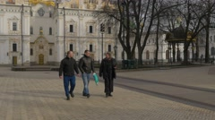 Men and Clergy Walking at Dormition Cathedral Day of Martha and Mary Part of - stock footage
