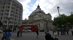 Driving and walking close to the Methodist Central Hall in London - stock footage